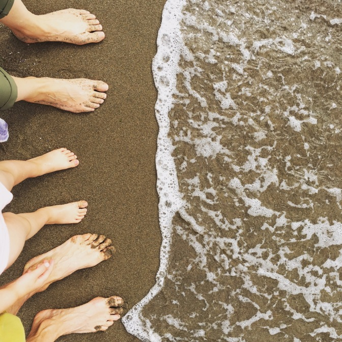 sand on our feet, waves licking our toes